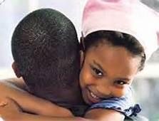 African  american girl hugging her dad