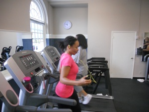 kim walking backward on treadmill